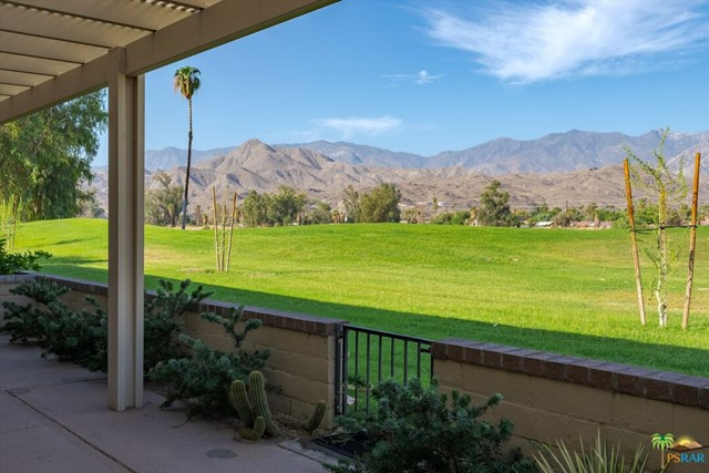 This updated 3 Bed, 2 Bath end unit features, a spacious patio with golf course and mountain views, high ceilings, wet bar, fireplace and tile floors throughout , except bedrooms. In addition there is also great separation of Master suite from the guest bedrooms and the garage features an enormous overhead storage area. Last, but not least, this move-in condition condo is being sold turnkey furnished, per Inventory List.
