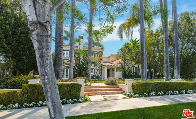 UPDATED PRICE: BEST HOUSE UNDER $7 million in the Flats of Beverly Hills! This charming home is situated in the heart of the Beverly Hills flats on a lot of 13,232 sq. ft. This classic 2-story house leads to a beautiful living room with high beamed ceilings, NEW hardwood floors, over-sized fireplace and elegant French doors that open up to the covered patio and expansive backyard and pool. The formal dining room has a 2nd fireplace. Remodeled gourmet kitchen with center island and eat-in breakfast area with adjacent office. Large media room and downstairs bedroom suite plus powder room and laundry room complete the main level. Large master suite with beamed ceilings, large walk-in closet, inviting balcony towards backyard and pool. Glass gallery hallway leads to three additional large bedrooms and two full baths. Fantastic  lawn with hedges offering complete privacy, outdoor covered dining pavilion, pool and spa. Seller has plans for extending living room and adding ADU to house.