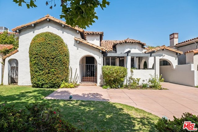 An amazing opportunity to own this Spanish-style 1930s home in a prime South Beverly Hills location a few blocks from Neiman Marcus & Saks Fifth Avenue & a block north of Roxbury Park. This one-story home has a gated front courtyard, formal entryway, large step-down living room with a beautiful picture window, fireplace & plantation shutters.  A spacious formal dining room next to the living room on one side and a galley-style kitchen on the other.  Separate laundry room & breakfast nook with a door to the front courtyard. 3 spacious bedrooms with en-suite bathrooms, plus a bonus office or den with a closet which could be a 4th bedroom. The primary bedroom has a sitting area addition, a walk-in closet & an original 1930s tile bathroom. Lovely backyard with lawn area & mature fruit trees & landscaping.  The detached garage has been converted to an art studio.  An amazing value, this is a trust sale and an opportunity for you to remodel or rebuild this home to your own taste & style. A motor court in the front of the property with room for 3-4 cars and a long driveway on the side of the back of the property. Property is equipped with a solar system. Buyer will agree to have the present solar lease transferred to them at the close of escrow and assume all liabilities and responsibilities under the lease.