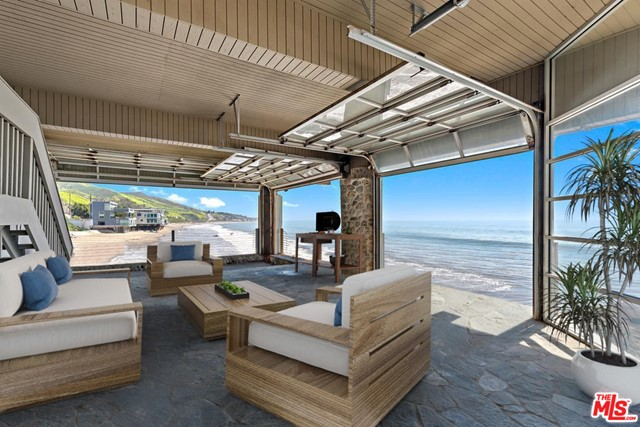 One-of-a-kind romantic beachfront condominium with uncompromising views from Santa Monica to Catalina and beyond. Very rare opportunity to own a part of Malibu's last pristine private dry sand beach. Unlike other Malibu beachfront enclaves this exceptionally private 4-unit icon stands alone away from the crowds yet offers walking distance to Solstice Canyon & world-class dining. Spacious open floor plan for entertaining, whitewater views from every room, floor-to-ceiling windows, recessed lighting, two oceanfront decks, marble floors, Poggenpohl kitchen cabinets, granite countertops, Miele appliances, induction cooktop, three bedrooms plus a sleeping loft, one bedroom has private entrance w/kitchenette, two & a half baths, washer & dryer inside, two private parking spaces, add'l guest parking w/ample storage. Living room & master bedroom w/fireplace, huge beachfront common area deck, BBQ, bathroom, shower, ocean view dry sauna, your very own private beach oasis.   Also, lease 12.5K mo