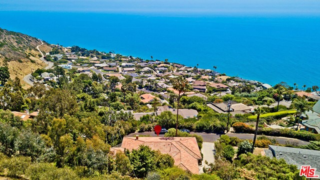 Beautiful contemporary single-story OCEAN views Malibu home in desirable Big Rock neighborhood. Charming 3 bed 2 bath, elegant living room w/ fireplace, dining room + bonus Den w/beautifully updated hardwood floors throughout. Remodeled kitchen has new stainless steel appliances including dishwasher, washer/dryer & new cabinets. Outdoor Spa. Large driveway parking area + enclosed 2 car garage. Minutes away from Santa Monica, Malibu Pier/Country Mart & Pepperdine University. Best value in BIG ROCK neighborhood, Malibu! Property is tenant occupied & will be vacant on September 16th. Available for showing w/ 24 hour notice. Pls text/call Angel @ 310.721.7817
