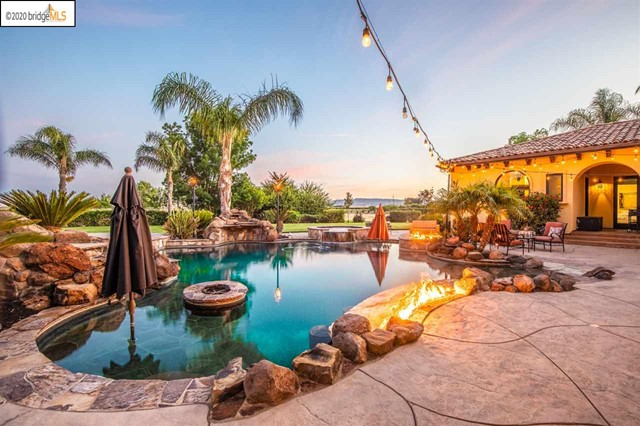 Luxury 10 acre property with views of Mt. Diablo and all the amenities of country living yet minutes from Downtown Brentwood. This is more than just a home, it is everything you could ask for in a venue, place to watch a family grow and so much more.  The property surroundings include Fruit trees, large backyard grass area, a pool, hot tub, firepit,  barn and four car garage. Gourmet kitchen with a wet bar, breakfast nook, island, Viking appliances, and more! Formal dining room and wine cellar. Master bedroom includes office space, gas-burning fireplace, living area and views of the backyard with two entry doors to the outdoor patio. The master bath includes a makeup vanity and his and hers sinks with a jetted tub and walk in shower/sauna. Immaculate living room with high vaulted ceilings, crown molding, fireplace, ceiling fans and hardwood floors with a large entertainment center!