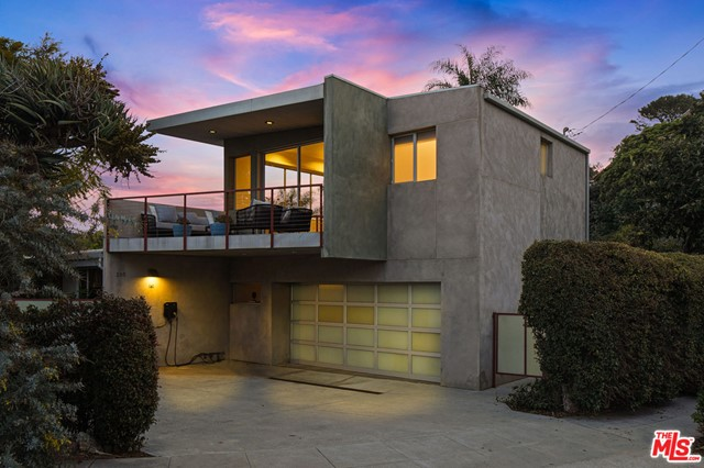 Warm & bright 2-level Santa Monica Canyon contemporary home designed by renowned LA architect Mark Mack. Beautiful views of Santa Monica Canyon make this peaceful, private retreat a special place to call home. The generously sized & sophisticated master bedroom suite is upstairs with walk-in closet, fireplace, large balcony & expansive vistas. There are 3 additional bedrooms, 2 additional bathrooms & a large, inviting family room on the 1st level. Abundant natural light permeates with many skylights & large windows. Hardwood floors, a Philips Hue lighting system, SONOS music system, remote-controlled shades & many dramatic architectural details fill the home.  A large deck, perfect for dining al fresco, overlooks a lushly landscaped backyard with a flat, grassy lawn as well as mature trees & plants. Not to mention, there's a secret basement Speakeasy wine room & bonus storage space! Easy beach access at the end of Mabery, trendy restaurants & Canyon Elementary School are all moments away.