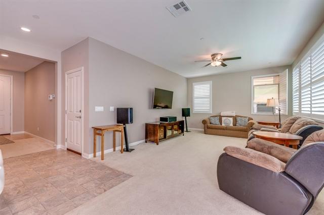 Plush carpet in over-sized Living Room.