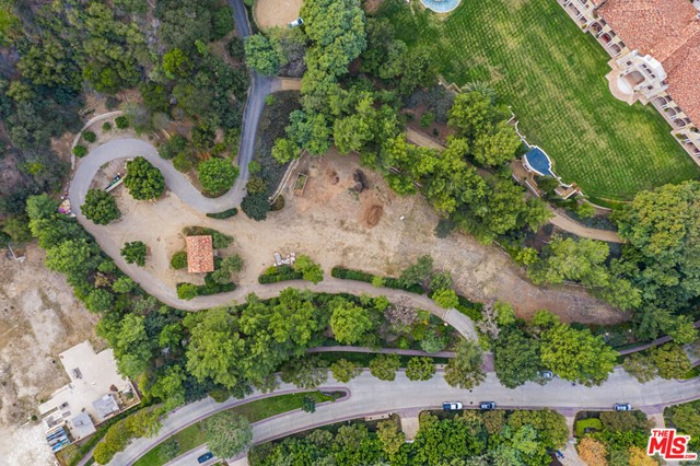 Set behind the exclusive and secure gated enclave of North Beverly Park and situated on approximately 2.82 acres, this lot is a spectacular development opportunity to build your dream estate.