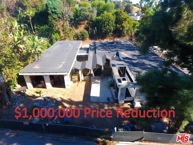 PRICE REDUCED $1MM - Situated on Loma Vista Dr, located in the Trousdale Estates of Beverly Hills, this elevated home is a highly desirable area of Beverly Hills, 90210. The home, currently under-construction, is being marketed to builders, investors, or home owners, who would be interested in completing construction and putting their personal touch on the property with their choice of finishes. The re-designed home is framed, has a foundation, most of the subsurface flooring, electrical and plumbing roughed-in, and roofing mostly complete. The home was originally built in 1959, and many of the original elements remain, including the vintage fire place/chimney chute, the folded-plate roof design in the entrance, living room, and family room. The re-design of the property has provided the home contemporary elements, such interior/exterior interaction, and a subterranean level.