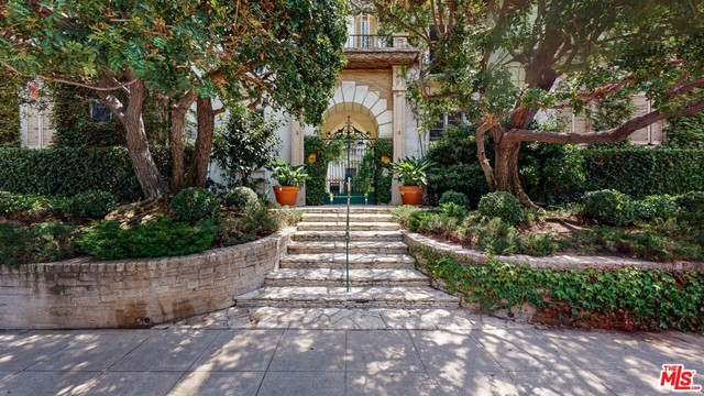 Il Borghese was built in 1929 by architect Charles Gault. Once in a great while do units ever become available in this 1929 courtyard gem. Truly gorgeous top floor unit at Hancock Park's Il Borghese, featured in David Lynch's film Mulholland Drive. This beautifully done home has been tastefully remodelled. The once in a lifetime opportunity features gorgeous vaulted beamed ceilings, wide plank hardwood floors, period light fixtures, decorative ornate fireplace, stainless steel appliances in the kitchen, amazing original tile work in the bathroom, arched doorways. One of LA's most prestigious and incredible architectural buildings.  And there is the added comfort of central air & heat. Wonderfully located near shops, restaurants, yoga and minutes to everything you'd need. There is even a rooftop deck with a barbecue area and chairs to lounge, relax or entertain. Or just have a drink and take in the incredible panoramic views of the LA skyline.