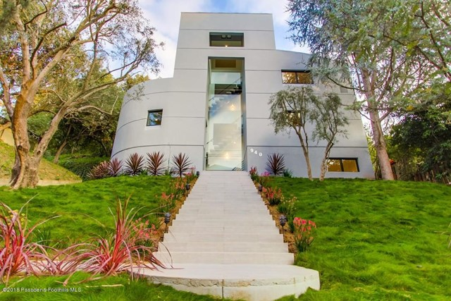 Nestled on a tree-lined street in San Rafael's estate area, this exquisite architect-designed home resembles a piece of contemporary art. Completely remodeled & rebuilt with quality construction & designer amenities in 2018, this stunning home is situated in a highly desirable neighborhood with easy access to all freeways. This dramatic architectural gem boasts features walls of glass, private greenery views and a seamless indoor-outdoor ambiance. A grand staircase ushers guests into a sensuous LR, a step-up DR and an open, sleek kitchen with German cabinets, stainless steel appliances & Quartz countertops. Doors open out to the rear terrace and carport. Dramatic floating stairs & a private elevator connect all four levels of this modern home. Three spacious light-filled BRs, four luxurious BAs, a huge FR with entertainment balcony and a lower level media/game room with bar complete this unique home. Close to Old Town restaurants and shops, biking and hiking trails, the Rose Bowl and easy freeway access to DTLA, studios & westside, this is a special jewel in the prestigious San Rafael area of West Pasadena.