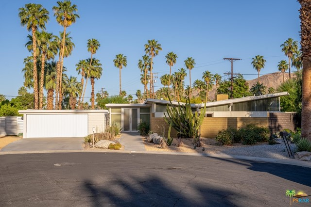 A rare 1957 Krisel-Palmer, built by the Alexander Construction Company in the Twin Palms Estates neighborhood of South Palm Springs is now available. Twin Palms Estates was Coachella Valleys first George Alexander Construction Company subdivision, originally dubbed Smoke Tree Valley Estates. This successful subdivision was designed by Bill Krisel with Dan Palmer, 90+ homes were designed in three stages, the first two being Twin Palms Estates, the third, 19 homes in the middle of the adjacent El Camino Estates. 1860 Aquanetta Circle is situated on a quiet cul de sac, with 180-degree mountain views. This classic Krisel-Palmer 3-bedroom, 2-bath home, in essentially original condition features a butterfly roof with post and beam construction and its original bleached wood ceiling. An 1,805 SF interior boasts a wood burning fireplace in the living room, clerestory windows throughout, sliding glass doors in good working condition, original extra tall aluminum and glass double entry doors, carport conversion to garage, and so much more. With only two previous owners, this Krisel-Palmer will satisfy midcentury modern purists who want a mostly original pedigreed property or midcentury modern enthusiasts wanting to put their own stamp on it.The house sits on a 11,761 SF lot with mature fruit trees, a rear and two large side yards and pool. Come see why Twin Palm.