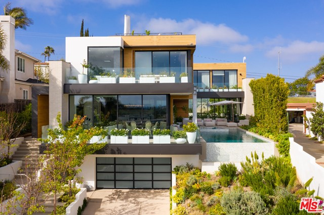 A sleek, contemporary and truly one-of-a kind architectural masterpiece located in the heart of Santa Monica. Built in 2017, this custom home sits atop the highest vantage point on Berkeley boasting jaw-dropping panoramic city and ocean views.  An open concept with soft-modern finishes of wood, stone and imported tile throughout. This immaculate estate offers elegant indoor-outdoor living areas and features a true chef's kitchen with a built-in Thermador package including a double oven, oversized refrigerator and a top-of-the-line espresso machine. Showcasing a negative edge infinity pool/spa, free-floating staircase with glass handrails, rooftop patio, grassy backyard area with a built-in BBQ and pizza oven, 500 bottle temperature-controlled wine room and a full-sized wet bar with onyx countertops. Stroll downstairs to workout in your home gym or unwind in a fully customized 7-person home theatre with a Steinway-Lyngdorf projection screening system designed by DSI Luxury Technology. Also included is a state-of-the art security system and a fully integrated Crestron-Savant smart home automation system. Centrally located just minutes away from the Beach, Brentwood Country Mart, Brentwood Country Club, Downtown Santa Monica and other premiere shops/restaurants.