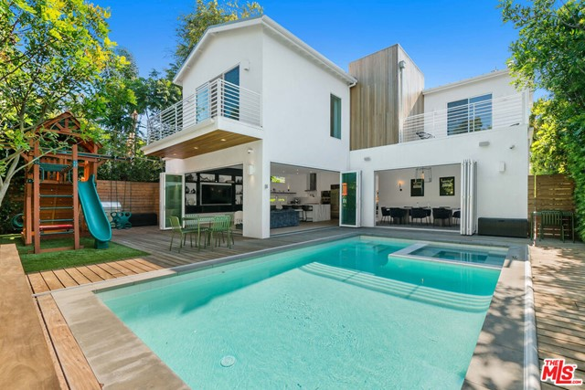 Modern and inviting Venice compound with exceptional upgrades in a sought-after neighborhood setting. Inspired by Scandinavian design with Santa Barbara white stucco and cedar siding, the newly constructed 2017 home offers refined sophistication and Westside style. Enter through a lush and private front yard into a sun filled, light and bright smart home with high ceilings, wide plank white oak floors, oversized windows, custom lighting, surround sound and fireplace. The gourmet kitchen is outfitted with Wolf and Subzero appliances and highlighted by a book-matched Bluette Covelano marble island with a waterfall edge. An entertainers dream home, the living and dining rooms open up to an Ipe deck via cantilever doors to a sparkling saltwater pool & spa.  A grand staircase leads up to the second floor with 2 spacious bedrooms (with en-suite bathrooms), laundry room, and grand master suite featuring walk-in closet, balcony, and spa like bath with steam shower and soaking tub. Beautiful views from every window. This is a truly spectacular home.