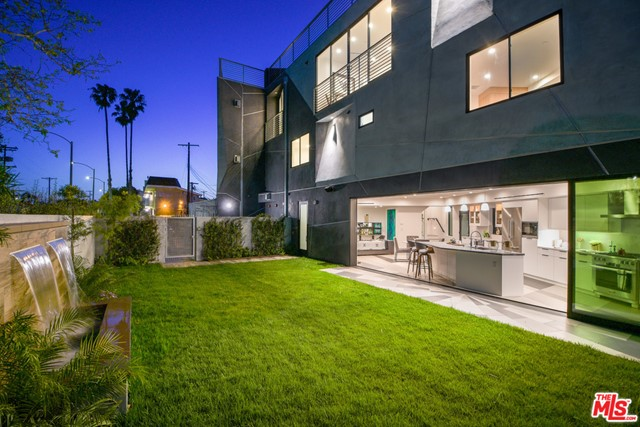 The ONLY home of it's kind. This one-of-a-kind new construction architectural masterpiece is in the heart of Venice & can never be recreated. Walk a few steps in any direction and your toes will be in the sand, your taste buds will enjoy Abbot Kinney's finest & your escape to the Italian-inspired Venice canals awaits. Sing your favorite songs from your built-in surround sound and create your favorite dishes with Miele appliances backing your skills. Designed to perfection, this open floorplan truly captures the indoor + outdoor living essence. More options to entertain? YES! Grill to perfection behind your compound's 6-foot walls & in your lush yard. The architectural arrangement enables you to see every detail of each first-floor section no matter where you stand. The second story doesn't disappoint either with 2 bedrooms, 2 bathrooms & 2 balconies. The third story brings you to your Master suite. Nestle up to your custom in-wall fireplace & get lost in the elements. You will want to take an extra long shower with the spa-infused bathroom and natural light pouring from above. Never miss an outfit for the right occasion with your gigantic walk-in custom white oak wood closet. On this floor is a guest suite for your home office & another impeccable ensuite bathroom. Vacation at home to the incredible 360 panoramic views on your private vast rooftop!