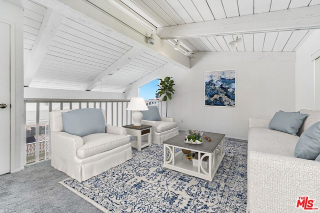 """Welcome to this beautiful paradise bay and surrounding areas in Malibu, right on PCH! The sellers are packed and ready to move! A few photos are staged for you! Brokers, this beautiful, high-end property offers 2 bedrooms, loft/third bedroom, 3 bathrooms, additional storage, and utility hookups perfect for families and beach fans. It boasts a bright, open kitchen with a breakfast bar that flows into the large living room with vaulted ceilings, a fireplace, large windows, carpeting, and a sliding glass door to the balcony with ocean views. Both bathrooms have recently been painted. There is also a den/office in the loft/3rd bedroom, as well as a 3/4 bath and two closets. Among the amenities of the gated community are a heated pool, a spa, and a sun deck. Among the HOA's services are earthquake insurance, trash collection, water, all exterior maintenance/landscaping, and a security guard. There are pet rules. Sellers are selling """"as-is,"""" and will not repair nor pay Buyers' closing costs. The end-unit townhouse is close to Beach Cafe, Paradise Cove, and Pepperdine University."""