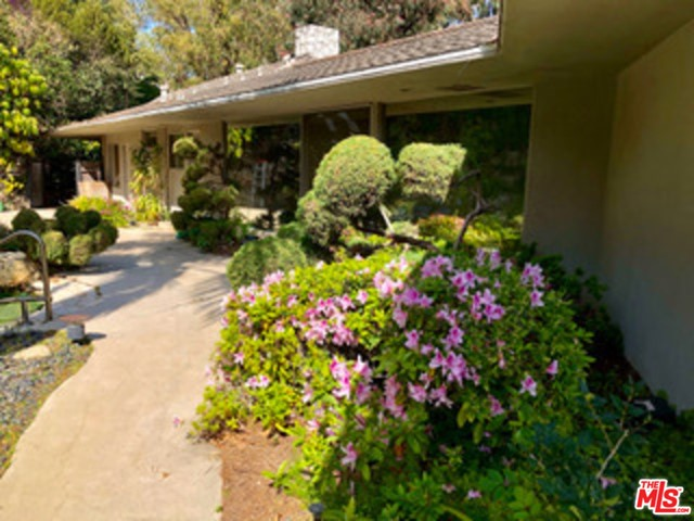A truly rare offering- this jewel of a property sits on over an acre of incredibly private park-like grounds.  This one of a kind single level mid-century home has been lovingly maintained. Enjoy the many charming details including a circular dining room with a rotating floor and walls of glass overlooking serene views and Japanese garden. Bring your designer and reimagine this gem or live here while planning to build a private estate overlooking serene views above the treetops. Located in the coveted, guard-gated Brentwood Circle community in prime Brentwood.