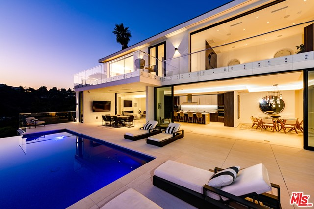 Perfectly situated in prime Bel Air, sits this pristine, newly-built, contemporary masterpiece.  Enter into the expansive, serene and open floor plan which provides abundant space throughout along with explosive canyon, ocean, and city views. Designed with dramatic indoor and outdoor flow, including a massive 3,000 square foot outdoor patio set with a refreshing infinity pool, which is perfect for entertaining. Take note of the imported Italian marble from Antolini, beautiful Italian limestone floors,  Oak wood floors, Fleetwood doors and Lutron Lighting system. The custom Italian kitchen was designed by Aran Cucine and outfitted with Miele appliances. The elegant master bedroom suite has a private balcony along with 5 additional en-suite bedrooms all offering wonderful views. The property includes a theater, game lounge, wine cellar, home office, plenty of space for a gym and second office. This is a wonderful opportunity to own an immaculately designed, organic, and private retreat.