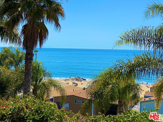 Unobstructed whitewater breathtaking ocean views from Palos Verdes to Malibu. A truly rare offering- this jewel of a property is steps from the sand. Perfect for entertaining with its indoor-outdoor floor plan. Large lot with two car spaces and generous storage units. Located on one of the most coveted streets in Tahitian Terrace, a manufactured home community. Amenities include large clubhouse for entertaining, heated pool, hot tub and exercise room. All ages welcome and pets are permitted. The buyer does not pay real estate property taxes or HOA fees. Protected under rent control. Space rent to the new buyer is approx $2,000 per/mth.