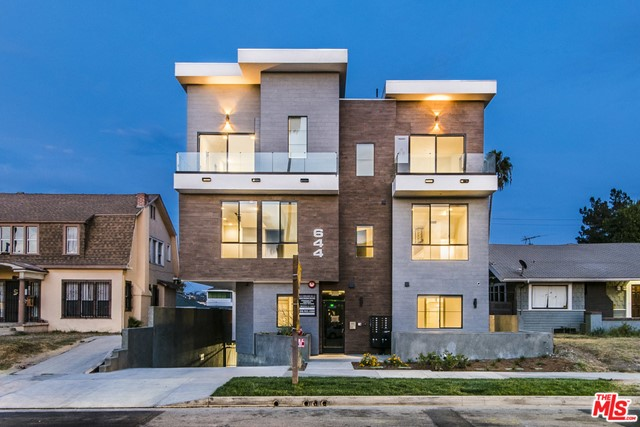 "Purchase 13 brand new, luxurious, NON-RENT CONTROLLED Townhomes. Situated in the highly desirable East Hollywood submarket. Each unit has modern interiors with many amenities including custom Italian style kitchens, quartz countertops, in-unit washer & dryer, modern appliances, deep soaking tubs, Nest Thermostats, secured building, and private rooftop decks. Contact listing agent for a showing. The property is approximately 11,660 sq. ft. gross plus a subterranean garage. *Property will be sold ""AS IS"" condition with a deed restriction preventing it from being converted to condos for 10 years from the date of CofO."