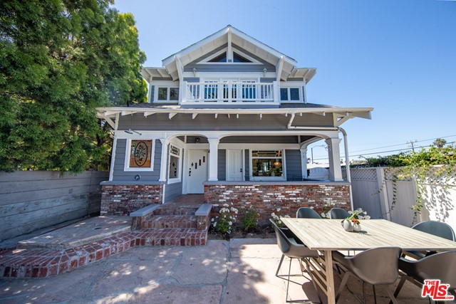 Lovely California Craftsman on gorgeous Venice walk-street only seconds to the sand and Abbott Kinney! This updated 1911 4 Bedroom, 5 Bath home, includes unique architectural Craftsman touches such as tapered columns, exposed wooden beams, covered front porch, repointed brick, and hardwood floors. Enter through the front gates into your private oasis; enjoy a brick-lined expansive covered porch with a built-in firepit, garden & outdoor shower after surfing. Continue inside to a spacious open floor plan, fabulous living room, windows surrounding patio & garden, fireplace, bar, office, and brick walls throughout. Enter into the spacious dining area, cooks kitchen and concrete counters, floating wood shelves, stained glass windows from the 60s, new stainless steel appliances, and all new kitchen cabinets. On the upper level, enjoy three sun-filled bedrooms, each with full bathrooms including a Master Suite with a private balcony + fireplace. Parking: 6 cars on-site.