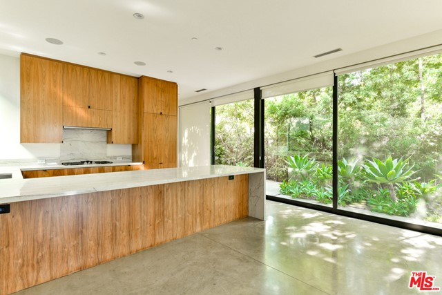 Gorgeous Marmol Radziner-designed home on the much desired Milwood Ave! Flooded with natural light, the ground floor features a great indoor/outdoor flow w/ 10-foot ceilings and a wall of sliding glass doors that open to a lush yard with BBQ & fire pit. Located in the heart of Venice, this dramatic and spacious home has been built using the finest materials. The chef's kitchen has top of the line Miele appliances, oversized walk in pantry w/ wine refrigerator, ample walnut cabinetry and breakfast bar - an entertainer's dream! Upstairs, an all-purpose office/play space, a swoon-worthy master suite with his and her walk-in closets; two additional bedrooms with en-suite bathrooms; and a walk-in laundry room. Complete with state of the art security system and 2-car garage with electric vehicle charging port + two additional spots for a total of 4 parking spaces. This fabulous home offers the opportunity to experience Venice living at its finest!
