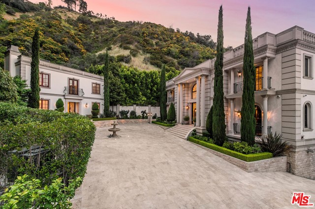 Situated on a nearly 5 acre lot in prime Bel-Air, this classically-inspired 8BD/12BA residency totals 17,415 Sq.Ft. Enchanting 30 ft high ceilings greet you at entry. Exquisite finishings throughout include crown moldings, imported marble, refined hardwood floors, Corinthian columns, and rare stones in the bathrooms and countertops, amongst others. The main level features spacious formal living and dining rooms with fireplaces, kitchen and breakfast room with butler's pantry, game/billiards room, and gorgeous library. Up a sprawling staircase, the upstairs is home to the master suite boasting dual closets and baths as well as a weather control winter closet, terraces affording reservoir views, plus 3 addl en suite bedrooms. Lower level features an indoor lap pool, full-size sauna, and a massive steam room with a custom marble table for body treatments. Other features include elevator, entertainment room, and a detached two-story guest house.