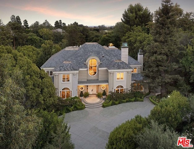 Located within prestigious Holmby Hills, this classic traditional estate by acclaimed builder Gordon Gibson sits on over an acre of land on one of the most coveted streets in Los Angeles!  The private double gated entry, expansive motor court and circular drive open onto this timeless estate with rolling lawns, beautifully landscaped grounds, glistening pool and lit tennis court.  Ideal for living and entertaining with an effortless flow and impressive scale, this beautiful home features a grand entryway with a dramatic staircase, an abundance of light, two large formal dining rooms, three expansive living rooms all surrounding a double-sided bar for social and family gatherings, a chef's kitchen, wood paneled library with a fireplace, comprised of 5 bedrooms en suite, including a large master suite with dual bathrooms and spacious walk-in closets, a pool and spa with fountain features, and an abundance of parking.   This is truly an incredible opportunity!  Shown to pre-qualified clients only.