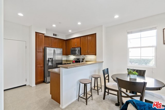 Kitchen opens to dining/living area