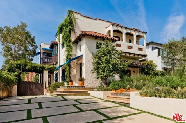 One-of-a-kind Spanish home just blocks from the heart of the Palisades Village exudes authenticity and charm. Lush, romantic landscaping, tiles and awnings add to the character of this home's exterior. An inviting entry leads to large living and dining rooms, followed by an eat-in kitchen with hand-painted tiles. The main level is completed by one guest suite and a family room that opens to a dining patio surrounded by bougainvillea. The upper level consists of a fabulous primary suite which includes a large sitting room, two walk-in closets and a step-down bath with vintage tile. Two additional bedrooms and one shared bath are also on the 2nd floor. Ocean views can be enjoyed from the primary suite and additional bedroom. The garage has been converted to a wonderful, bright multi-purpose room with wood floors, a bathroom and well-designed laundry room. The grass yard allows for plenty of space to run and play, and there is a side patio with a large fountain for additional use of the outdoors/entertaining. Tract 9300. Seller does not know condition of chimney and will not do repairs or give credit. See DOCS for offer guidelines and ask agent about reports/disclosures.