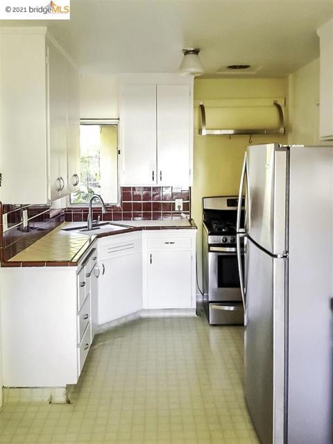 Kitchen now has light grey vinyl hardwood flooring.