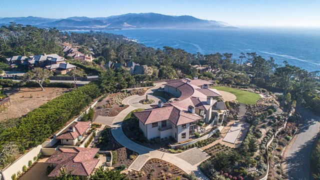 Deemed one of the best locations in Pebble Beach, with views from Cypress Point to Pescadero Point and down the coast, this magnificent property exudes chic sophistication and contemporary elegance with ocean views from nearly every room. Built just four years ago on 1.7+ acres, every inch is flawlessly rendered with uncompromising quality and detail. Crisp white walls stand ready to display fine art, clear glass railings offer unimpeded views, and massive windows present the ocean at every turn. Spanning two levels serviced by an elevator, the main residence totals 8818 sq. ft. with four bedroom suites, 2 family rooms, living room, a formal dining room, a media room, library, and wine cellar. Separate one-bedroom guest cottage with 834 sq. ft., full kitchen and family room, and a second residential caretaker's unit with 304 sq. ft. + garage 980 sq. ft. The grounds invite California-style living with a bocce court, fire pit, and a myriad of venues for entertaining.