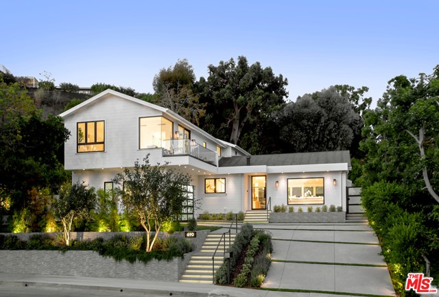 This newly completed Coastal Contemporary Style home has an incredible design, floor plan and feeling on an oversized lot with large backyard and ocean views. This architectural offers 5 bedrooms, 5.5 baths with 3,744 SF of living space on a 9,079 SF lot in the sought after Marquez Knolls neighborhood. Sitting above street level, walk through your beautiful metal and glass front door to an open living room, with custom recessed lighting, fireplace, and bi-fold sliding doors to your large backyard. The kitchen features clean design and custom lighting that brightens the beautiful white oak cabinetry and wine display. This home shows details that differentiate itself from other properties, the carpentry, custom windows, lighting and design are all very special and is not what you see on a regular basis. Stationed only minutes away from hiking and biking trails and the ocean. This property grants access to all Pacific Palisades has to offer and is 5 minutes from Palisades Village!