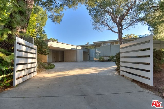 A Mid Century lover's dream in Beverly Hills!!! Three level REX LOTERY trophy home in Trousdale. Gated, on a good sized lot with pool,yard and  beautiful city views.  Floor to ceiling windows make this a very bright home.  Large primary suite has huge closet space, sits alone in the upper level. Powder room and family room. Maids room and bath.  Two additional bedroom suites downstairs open to yard.  Big entry room walks you  into an ample living room with fireplace, opening up to large yard with pool and views.  Formal dining room, and spacious kitchen.  Three car covered parking and lots of additional parking behind gates. Almost four thousand square feet per tax assessor.