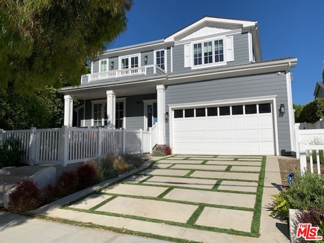Gorgeous and spacious Cape Cod Home constructed in 2018 with sparkling pool, spa, waterfalls, and Baja shelf. The yard  also has a fire pit with built-in seating area. This 4,341 home features 5 bedrooms plus 6 bathrooms and sits on a 6,731 square foot lot. The living room has a fireplace and lovely built-in cabinets. There is a formal dining room that opens to a butler's pantry. The kitchen features quartz countertops, a full size refrigerator and full size freezer, cooks range, built-in microwave, dishwasher, built-in ice-maker, and large center island with breakfast bar. The breakfast area has built-in seating. The family room features a fireplace, built-in cabinets, and electric window treatment at the sliding glass door. When you go upstairs, there is a loft with bar featuring a wine refrigerator and sink. The sumptuous master suite with vaulted ceilings has a fireplace, balcony, and lovely view. The master bathroom has double vanities, large shower, separate tub, and walk-in closet with built-ins. All bedrooms have en-suite bathrooms. This smart home has a security system, built-in speakers, and SONOS stereo system inside and outside. There are hardwood and tiled floors, recessed lighting, a garage with Tesla charger, plus solar panels purchased and paid in full. No rental agreements. This home is really special!