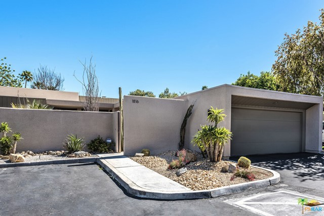 Great opportunity to put your personal touches on this fabulous large two bedroom + den home! Located in the heart of Canyon South 3, a wonderful architectural community in the coveted Twin Palms neighborhood, this home offers an updated kitchen, a huge living area perfect for entertaining thanks to its built in bar and fireplace, two en-suite bedrooms and a den which could be a third bedroom. With a two car garage, full laundry room, and a private patio, this is the perfect Palm Springs home. Canyon South 3 offers 2 pools and spas, as well as 2 tennis/pickle-ball courts. Canyon South 3 is on lease land with current expiration in 2041. Any financing will require a 15 year mortgage.