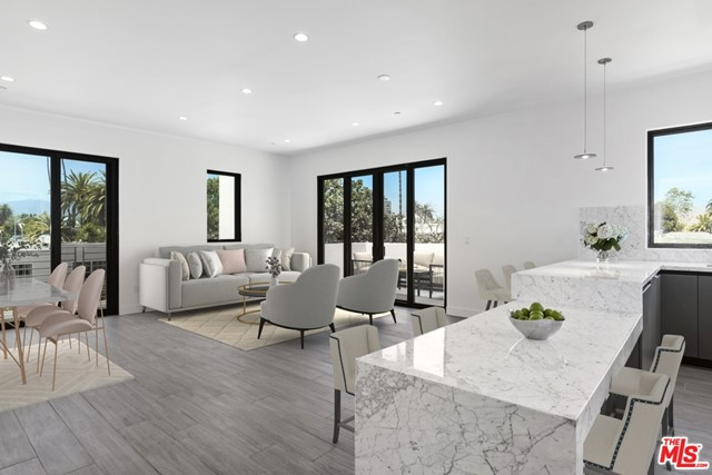 Rare new construction condominium in prime Santa Monica! Be the first to live in this top floor unit with spacious open floor plan, high ceilings, and no shared walls. Natural sunlight floods the entertaining space with large sliding glass doors and corner windows that showcase tree top views. Relax on the adjoining private balcony terrace and cook in the chefs kitchen with modern grey cabinetry, expansive Carrera marble waterfall countertops, and brand new appliances. Master suite has its own private terrace, stunning bathroom with double sinks, and walk-in closet. Guest bedroom is equally inviting with walk-in closet and beautiful en suite bathroom. Wood-like porcelain floors throughout provide easy living. In unit washer/dryer, LED recessed lighting, two side-by-side subterranean parking spaces, and large communal rooftop deck with mountain and city views. Enjoy the Santa Monica lifestyle at its best.