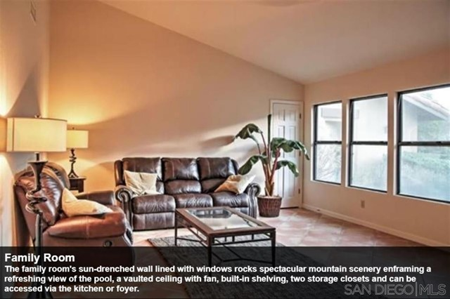 The family room's sun-drenched wall lined with windows rocks spectacular mountain scenery enframing a refreshing view of the pool, a vaulted ceiling with fan, built-in shelving, two storage closets and can be accessed via the kitchen or foyer.