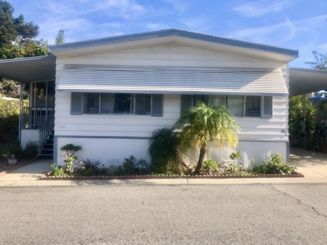 This home is located in a family park specifically Vista Meadows Mobile Home Park, a quiet and well maintained community. The floor plan is very spacious and includes new vinyl flooring throughout and a washer/dryer. Space rent is only $650 but may increase with the new owner application. This home includes a storage and sun room, sensor lights on the side and back of home. Every room comes with a ceiling fan and the walls are painted bright white. Please contact the agent to tour this beautiful home..  Neighborhoods: Vista Meadows Mobile Home Community Other Fees: 650 Sewer:  Sewer Available Topography: LL