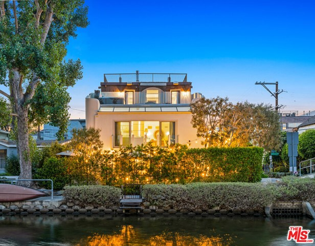 SELLER MOTIVATED. Breathe in the ocean air in this incredibly rare find located in the Venice Canal. This 5 bed / 3.5 bath contemporary home with parking for 6 cars sits on a corner lot with views from every floor and plenty of natural light that shines throughout. Enjoy the weather and entertain in style on the front patio with built-in BBQ, firepit and plenty of seating that flows into the large living room with a fantastic wet bar. The bottom floor also contains 2 guest beds and a bathroom. The main floor features an open concept living and dining room highlighted by high ceilings throughout and floor to ceiling French doors that peer out over the canal. Through the hallway you'll find two more large guest bedrooms and a large guest bath. The entire third floor boasts an expansive master suite that flows out onto a large balcony with breathtaking views that you can soak in as you relax in the hot tub. The master suite is rounded out by a stunning spa-like bath and plenty of closet space. Relax underneath the stars on the massive rooftop deck with 360-degree views. Whether you want to entertain or relax in style, this home offers a once in a life opportunity to enjoy all the best that Venice has to offer.