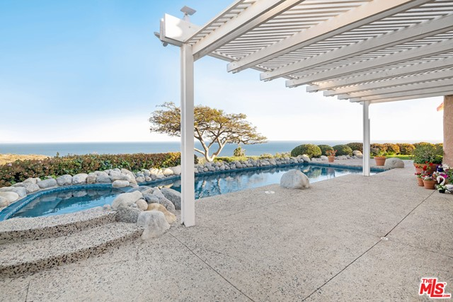 Great opportunity to purchase one of the best locations in Malibu Country Estates, spacious and private ocean-view home located at the end of a prime cul de sac. This single level home has incredible potential, with sweeping ocean views from kitchen, living, dining and primary bedroom. Four bedrooms and 3.5 bathrooms include the ocean view primary, with glass doors that open to the private pool and lawn where you can choose to entertain guests or kick back and relax. There is a three-car garage, with room for guest parking in an incredible location that is conveniently located close to downtown Malibu and beaches.
