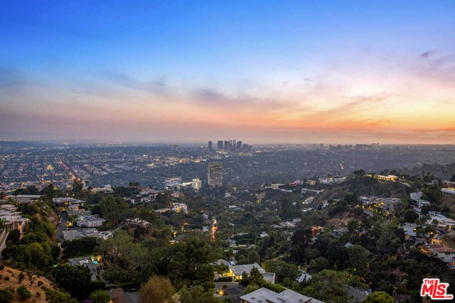 Located on one of the Best Bird Streets in the Sunset Strip, this drive-on promontory 360 degree view site offers one the rare opportunity to remodel the current home or create the home of their dreams. Perfect for an owner user or a developer.