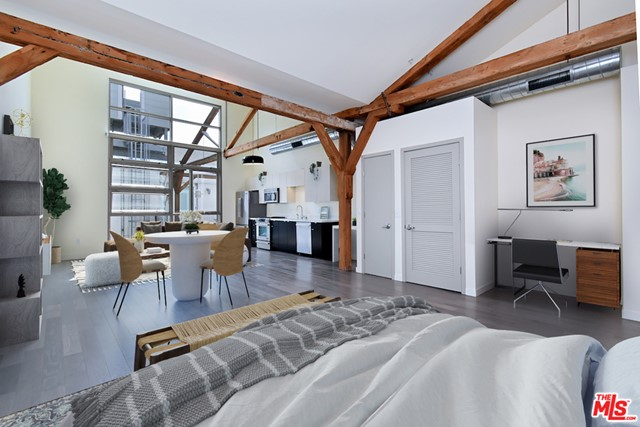 Top floor loft offers dramatic vaulted ceiling and double height dual pane windows which look out to a tranquil courtyard at Barker Block's Warehouse No. 1. Nestled away from active streets, providing  peace and quiet;  the perfect place for working from home. Century-old heavy timber posts and beams. Gorgeous grey hardwood floors. Stainless steel Jenn Air appliances. Quartz countertops. Soft-closing cabinets & drawers. Hugh designer bathroom. Washer-dryer in unit. Nest thermostat. Parking in gated, controlled access garage. Breathtaking resort-style rooftop pool/spa/BBQs/fire pits/fitness center. Free common area WIFI. 24/7 security. Across from Urth Caffe & the LA Cleantech Incubator. Quick access to a centralized freeway network. Near USC; walk to SCI Arc. Check out the red-hot Arts District - home to Spotify, Warner Bros. Music, SOHO House, award-winning 5- star restaurants like Bavel & Factory Kitchen, clubs, taverns and all things hip and trending.