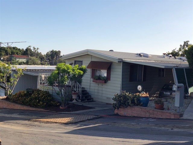 1977 2 Bedroom 2 Bath 1040 Sq Ft Manufactured Home with Wrap around deck, Large Shed, A/C & Newer Hot water heater in Low HOA Fee Coop Senior 55 + Park in rural part of Vista.... Very affordable option for seniors who need to downsize and be able to stay in Southern California. HOA is $230 per month! The bones of this home are good. Needs some fresh interior paint, newer flooring & updates to the liking of the buyer.... Can't beat this opportunity! Neighborhoods: Osborne Park Complex Features: ,,, Equipment:  Range/Oven, Satellite Dish, Shed(s) Other Fees: 0 Topography: GSL