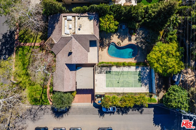 Incredible development opportunity on a premier Brentwood street. Developers, builders, and anyone looking for a once-in-a-generation chance to build your dream home, this is the one you've been waiting for! Sited on a rare, flat corner lot that's just under a half an acre with a pool and sport court, the property presents a prime opportunity to remodel or tear down, the possibilities are limitless. First time on the market in over 50 years, the 4500+ square-foot home has a formal living and dining room that both open to the backyard, a comfortable family room/den off the kitchen, and 3 bedrooms and 3.5 bathrooms on the main floor. Upstairs a large en-suite primary bedroom has a balcony that overlooks the pool and backyard, plus there's a bonus room that could be an office, playroom or extra storage. Amazing potential and fantastic location, north of Sunset in highly coveted Brentwood.