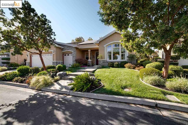 "Casual easy living at its best. A dramatically and aesthetically pleasing home with generous family and living areas. Rich decorator colors and features make this truly a custom home. Stainless steel appliances and granite counters in kitchen. One of a kind wall art in living room and kitchen set the mood for entertaining. Kitchen and adjoining family room share lovely views of golf course. Shady private patio with built in barbecue center promises many afternoons and evenings to be enjoyed outside with family and friends!!Generous Master suite with door out to patio! Comfortable Guest Suite. Seperate den/office allows for private space away from bedrooms. Formal living and dining room. Interior laundry room. 2 car garage with golf cart garage. Located at the end of a cul de sac with golf course views from the front of the home and from the backyard patio, this couldn't be a more perfect place to call ""home""!"