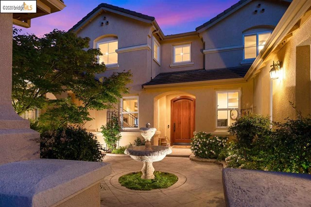 Two homes custom built on a quiet court in prestigious Apple Hill Estates. Enter the main home through private courtyard with tranquil fountain. Main home offers soaring ceilings in the family room with cozy gas fireplace. Large beautiful windows with an abundance of natural light. Over sized kitchen has custom wood ceiling & large eat in dining, upgraded appliances & built in fridge. Master suite & office with built in desk/storage are downstairs while 2 additional bedrooms are up the stunning wrought iron stairs. 3 car garage with lift for car enthusiasts. Meticulously landscaped. In-law unit has it's own garage & laundry for ultimate privacy. 1 large bedroom & bath with an open floor plan boasting a generous size family room open to its own kitchen & dining room. Out the back door to another private oasis with lush landscape & fruit trees. Use this home as an income generator or perfect for multi generational living. Entry Rules -http://nexthometc.com/files/2020/06/PRE-Posted-Rules-