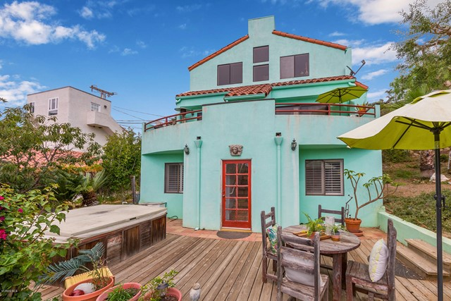 Super charming Malibu home being sold WITH THE ADJOINING VACANT LOT (APN 4457-018-004 5,652 sq ft - making your total lot approx 10,001 sq ft). This airy & bright home boasts both ocean & canyon views. There are 2 balconies, a large patio, and lots of yard area for fantastic outdoor enjoyment.  As you open the front door you will find a sunny skylight entry that leads  down 1 flight of stairs to the main floor where you will find a spacious living room with a fireplace and fabulous views out the sliding glass door that leads to balcony #1. At the back of the living room is a private office/study room. Across the hall you will find the kitchen and separate dining room with another sliding glass door leading to balcony #2 and another ocean/mountain view. There is a spacious pantry and laundry room off the kitchen and a half bath. The next flight down on the ground floor are 2 master bedrooms complete with full baths & closets. One contains a spacious walk-in closet. Both bedrooms have several windows for lots of natural light. The hallway door leads out to a full patio with more viewing pleasure and access to the wonderful yard containing several fruit trees including avocado, blood orange, peach, green apple, kumquat, and other orange varieties. Surrounded by world renowned beaches and hiking trails. Owner also has original plans & survey.