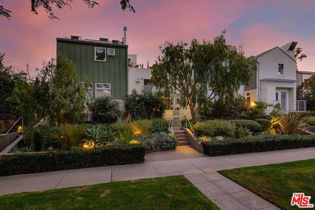 Stylish and sophisticated, newly remodeled Architectural masterpiece located in prime Santa Monica. Designed by award-winning architect William Dale Brantley, this one-of-a-kind stunning two-bedroom, two-and-a-half bathroom corner townhome residence has been gorgeously remodeled with incredible attention to detail and custom designer finishes. Enjoy a private and quiet rear location, (not located directly on Lincoln or an alley) with only one common wall, a large loft or flex-space (perfect for a home office, family room or playroom), a spacious, entertainers patio with plenty of room to dine, lounge and/or BBQ, lushly landscaped planters, and a private rooftop deck. Light and bright living spaces, and a dramatic multi-level plan includes soaring ceilings, skylights, wide-plank white-oak wood floors throughout and a gas fireplace with a new smooth, custom plaster surround. The gorgeous chefs kitchen features new Quartz countertops with a dramatic waterfall edge, stainless steel farmhouse sink, floating shelves, new recessed lighting and a custom built-in banquette with storage. Retreat to the incredible primary suite, a true sanctuary, with a newly updated 5-star, spa-like bathroom with new dual basin floating vanity, inviting soaking tub set in a recessed alcove with floating redwood shelving and a custom tile splash wall, along with an over-sized shower with a luxe marble finish, custom shampoo shelf, and Hansgrohe rainfall and shower wand plumbing. Additional highlights include a generous en-suite guest bedroom with new quartz top and a refinished vanity, powder bathroom, extra storage, new HVAC system with ActivTek air purification system, and a private, direct access two-car garage. Located just a stones throw to Montana Avenue, Third Street Promenade, and the beach. This is Santa Monica, luxury living at its finest.