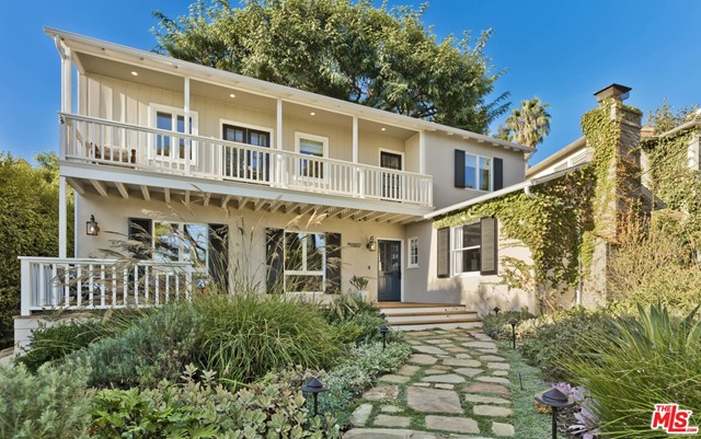 Graced with timeless Monterey Colonial-inspired architecture and sited on an exceptional 7,776-SF lot, this one-of-a-kind home is located above the Alphabet Streets, just 2-blocks from the Palisades Village. No detail was spared in the extensive renovation, seamlessly maintaining its warm and inviting charm while tastefully modernizing all the finishes. The residence features 3 bedrooms and 3 bathrooms, a light-filled living room, adjacent den/office, hardwood floors, two fireplaces, romantic master suite, a beautifully remodeled chefs kitchen with butcher-block island, and a Dutch door leading to the expansive backyard welcoming guests with a deck built around a mature Tipuana tree, flat grassy yard, immaculate landscaping, playset, firepit and semi-converted, oversized 2-car garage. Just far enough away from the hustle and bustle of the city, but moments from the best of the Palisades Village and minutes to the rest of the Westside, this quintessential home is not to be missed.