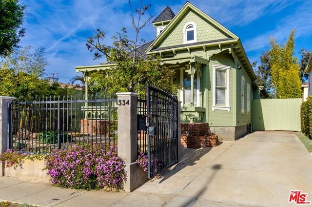 Welcome to the Venice home of your dreams-a peaceful retreat in a vibrant beach community!  This classic Venice Victorian featured in Cheech & Chong's iconic movie Up in Smoke has been lovingly updated into a modern home, while respecting the home's true character.  It has lots of natural light and benefits from healthy sea breezes and fresh air coming off the Pacific just 4 blocks away.  The home features an open floor plan, 3 bedrooms downstairs, ample storage, central A/C, hardwood floors, stainless steel appliances, granite countertops and a cook's kitchen opening to the rear deck. The upstairs features the ultimate work-from-home space/ home gym/ yoga room/4th bedroom with views of the mountains.  The home also features drought-resistant landscaping, drip irrigation, new exterior paint, custom gates and fences, an owned solar system as well as a charming workshop in the backyard. The convenient front-yard driveway is a rarity in beach communities.  Walk to the beach, Abbot Kinney Boulevard, Whole Foods and enjoy area restaurants like Gjelina or Gjusta!  Live the Venice lifestyle at its finest.