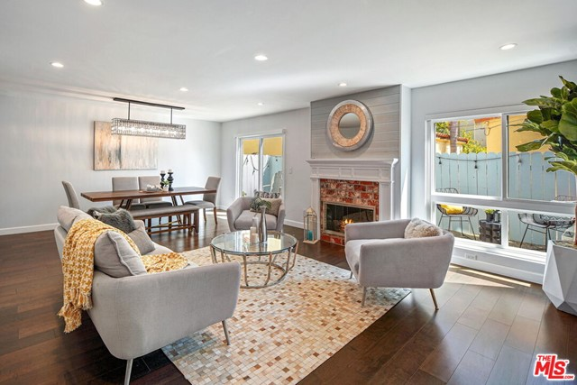 Sophisticated, contemporary Santa Monica 3BR/2.5BA+loft townhome located in the highly coveted Franklin Elementary SMMUSD school district. Meticulously remodeled throughout in 2016, this spacious unit offers over 2000sf of luxurious living space plus a direct entry, private 2 car garage with extra storage. Open living/dining/great room with sliding doors leading out to large patio makes for the ultimate in indoor/outdoor living. Soaring ceilings and walls of glass provide incredible natural light throughout the home. Gourmet kitchen with stainless appliances, custom cabinets, quartz countertops, farm-sink, wine-fridge and walk in pantry. Sun-filled, elegant Master Suite boasts cathedral ceilings, custom closet with built-ins and a loft (ideal for gym or office). Loft includes huge closet and has French doors leading out to an exclusive roof top deck with expansive tree top views. Two other generous sized bedrooms round out the second floor. Additional features: Hardwood floors throughout, fireplace, updated beautiful bathrooms, inside laundry, central air conditioning, ample closet and storage space with built-ins. Unique, incredibly quiet and private property that feels like a HOME. Small boutique building with 5 units. HOA includes EQ insurance. Just a stones-throw from all the hip restaurants and shopping on Wilshire/Montana. Don't miss this very special property.