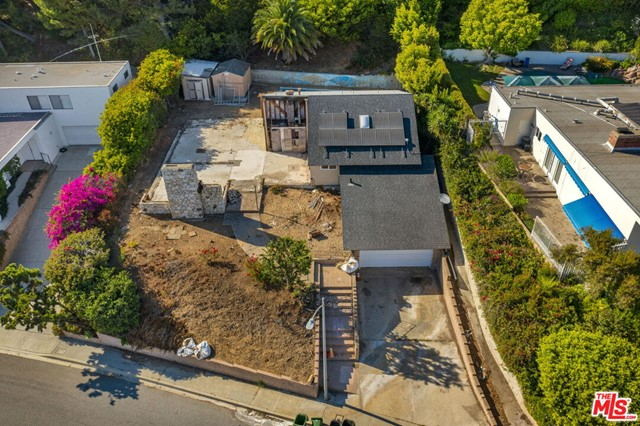 Have you dreamed of a new construction home with epic ocean views and all the finishes and details that were custom made to your taste? Bring your architect and your general contractor - we have your setting! Bring your dream home to life on this hard-to-come-by view property in the highly coveted Pacific Palisades. Situated on more than 13,080 SF lot, this property offers an unrivaled opportunity to reimagine your perfect home on a quiet knoll above Lachman Lane, secluded from the bustle yet just moments from all that Pacific Palisades has to offer. Immersed in nature and enveloped by trees, the lot holds boundless potential to host the home you've always wished for in an unbeatable locale. Call us for the details. Home is currently uninhabitable.